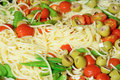 Italian pasta with mange tout closeup of traditional snow peas tomatoes chili and olives Stock Photography