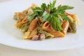 Italian pasta: mezze penne tricolore with pistachios pesto