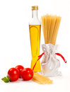 Italian pasta with olive oil, green and tomato Stock Photo