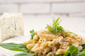 Italian pasta penne gorgonzola and pine nuts Royalty Free Stock Photo
