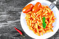 Italian Pasta Penne with sausages and Sun-Dried Tomato Pesto Royalty Free Stock Photo