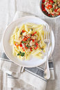 Italian pasta penne with with tuna, bell pepper and cappers