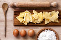 Italian pasta rolling pin flour eggs ladle wooden surface some ingredients to make and all on a in a plate of cork Stock Photo