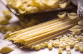 Italian pasta several raw on a table Stock Photography