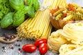 Italian pasta, spaghetti, fettuccine nest with garlic, tomatoes Royalty Free Stock Photo