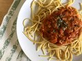 stock image of  Italian pasta spaghetti with tomato sauce and basil