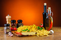 Italian pasta still life with herbs spices and olive oil Royalty Free Stock Photography