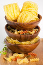 Italian pasta three species in wooden bowls Royalty Free Stock Photography