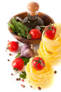 Italian pasta, tomatoes and ingredients Royalty Free Stock Photo