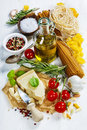 Italian pasta with vegetables herbs spices cheese and olive oil Stock Photos