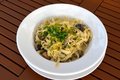 The Italian paste with mushrooms in creamy sauce - tagliatelle Royalty Free Stock Photo