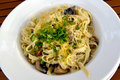 The Italian paste with mushrooms in creamy sauce - tagliatelle. Royalty Free Stock Photo