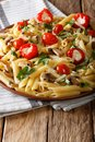 Italian Penne pasta with fried mushrooms, tomatoes, pepper and P Royalty Free Stock Photo