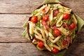 Italian penne pasta with ham prosciutto, tomato, zucchini and pa Royalty Free Stock Photo