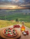 Italian pizza in Chianti, vineyard landscape in Italy Royalty Free Stock Photo