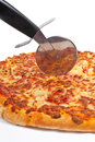Italian pizza and cutter Royalty Free Stock Photo