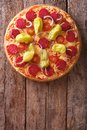 Italian pizza with salami and pepper vertical top view rustic pepperoni tomatoes on a table close up from above style Royalty Free Stock Photo