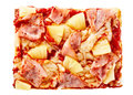 Italian pizza slice topped with ham and pineapple Royalty Free Stock Photo
