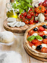 Italian pizza with tomato mozzarella and olives basil Stock Image