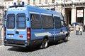 Italian police rome april people walk by van on april in rome is known for using only made vehicles iveco Stock Images