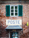 Italian postal office tuscany sign on old wall Stock Images