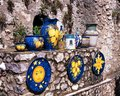 Italian pottery ravello italy displayed on outside wall for sale amalfi coast campania Royalty Free Stock Photo
