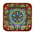 Italian pottery traditional ceramic plate with multicolor ornaments Royalty Free Stock Photos