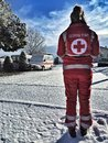 Italian red cross volunteer voluntary young component of the cri courtyard white with snow Stock Images