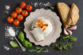 Italian ricotta cheese, homemade bread, vegetables and herbs Royalty Free Stock Photo