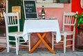 Italian ristorante served table with white table cloth restaurant and wooden chairs old vintage furniture wine goblets cafe Royalty Free Stock Images