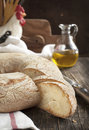 Italian round bread on wooden table Royalty Free Stock Image