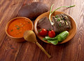 Italian rustic dinner tomato soup or pappa al pomodoro and roasted beef and vegetables with bread farm style Stock Image
