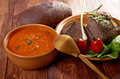 Italian rustic dinner tomato soup or pappa al pomodoro and roasted beef and vegetables with bread farm style Royalty Free Stock Image