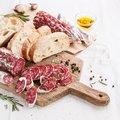 Italian salami on wooden cutting board Stock Image