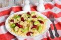 Italian Sausage Bowtie Pasta warm salad with avocado slices Royalty Free Stock Photo