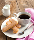 Italian savoiardi cookies ladyfingers and cup of coffee Royalty Free Stock Image