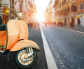 Italian scooter and old building style in rome use as traveling Royalty Free Stock Photo