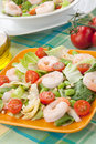Italian shrimp salad two plates of with shrimps tomatoes artishocke hearts romane lettuce leaves fava beans and pine nuts olive Stock Photo
