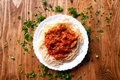 Italian spaghetti on a wooden table with text space Royalty Free Stock Photo