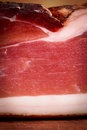 Italian speck on chopping board Royalty Free Stock Images