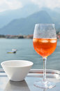 Italian spritz cocktail against lake como italy traditional Stock Photos