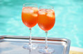 Italian spritz cocktails pair of traditional at the swimming pool Stock Photo