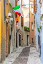 Italian street complete with flag coloured buildings and cobbled pathway Royalty Free Stock Photo