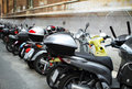 Italian street with parked motorcycles Stock Photography
