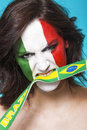 Italian supporter for fifa biting brazil flag beautiful and aggressive world cup the Royalty Free Stock Photo