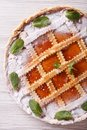 Italian tart with apricot jam close up vertical top view on the table Royalty Free Stock Images
