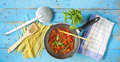 Italian tomatoe sauce with spaghetti plus herbs and kitchen utensils Stock Photography