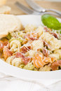 Italian tricolour pasta with creamy sauce and parma ham garnished parmigiano reggiano crusty bread on side Royalty Free Stock Image