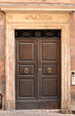 Italien front door brown in an italian town Royalty Free Stock Photos