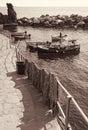 Italy. Cinque Terre. Boats in Manarola village. In Sepia toned. Royalty Free Stock Photo